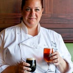Voorhees Iron Hill Brewery chef Tiffany Giove makes a voodoo sauce, marrying barbecue sauce and its Vienna Red Lager for a spicy melange that's featured in its shrimp and chicken pizza dishes, Thursday, July 31, 2014 in Voorhees.