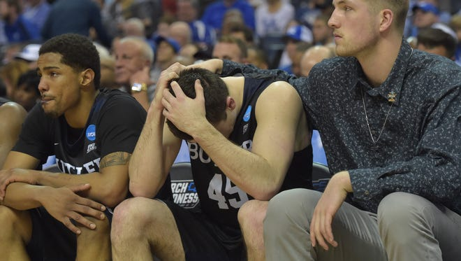Butler Bulldogs forward Andrew Chrabascz (45) reacts on the bench in the second half against the North Carolina Tar Heels during the semifinals of the South Regional of the 2017 NCAA Tournament at FedExForum. North Carolina won 92-80.