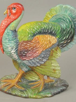 This iron turkey doorstop was made by Bradley and Hubbard. It is the only painted example known. In 2015 it sold for $1,700 at a Bertoia auction. The 12 1/2-inch-high bird is pictured in the Bertoia doorstop book.