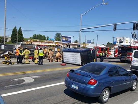Salem Fire Department officials respond to a rollover