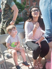 2-year-old Rylan Strother listens as his mother Amber