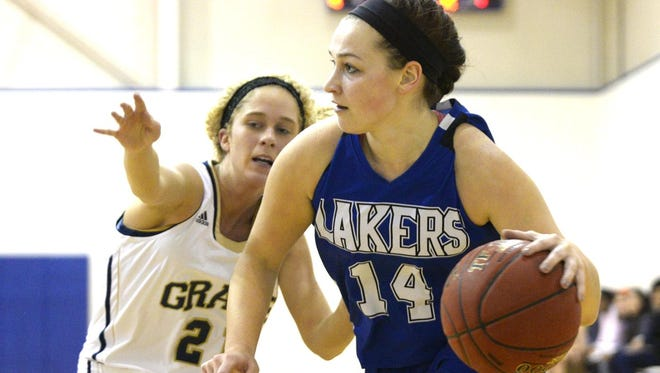 Silver Lake College junior guard Amanda Kudick drives to the basket during Saturday's game against Grace Bible College.