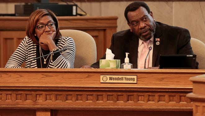 City Councilmembers Yvette Simpson, left, and Wendell Young, right, listen as Cincinnati Park Board executive director Willie Carden, Cincinnati Park Board of Commissioners chairman Otto M. Budig Jr. and Park Board superintendent Steve Schuckman present a report to City Council's budget and finance committee, Monday, March 28, 2016, at Cincinnati City Hall.