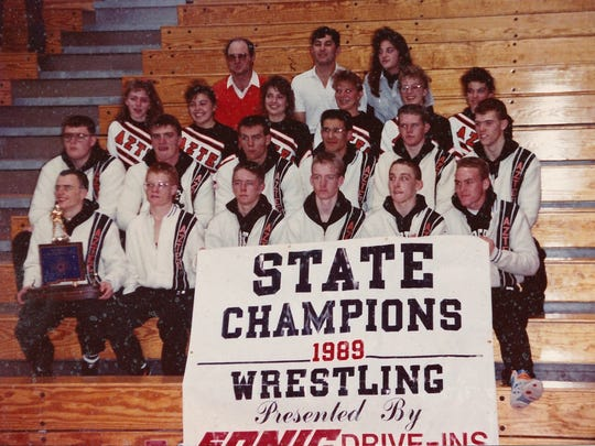 The Aztec High School wrestling team poses for a photo after winning the state title during the 1989-1990 season.
