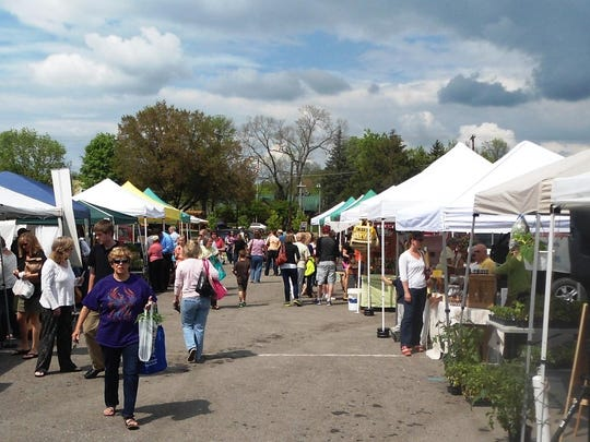 People milling around the Farmers' Market on market day was a happy place for Donna Bednar and the Loveland community.