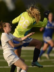 De Pere Anna Boyd (17) collides with Green Bay Southwest