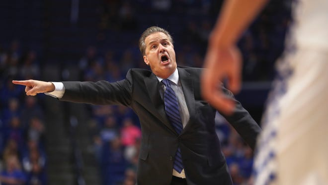 """Kentucky head coach John Calipari yells in the second half Friday night at Rupp Arena. The Wildcats won 78-61 after a sluggish start early in the first half. """"I would tell our fans, just enjoy this, because I'm the one dying,"""" said Calipari afterwards."""