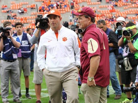 Clemson head coach Dabo Swinney (left) and Florida State head coach Jimbo Fisher talk before the game in Clemson.