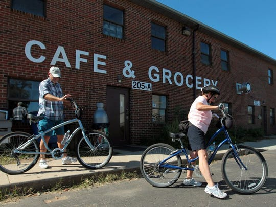 Lynna Landis and Russ Landis get on their bicycles after stopping at the Swamp Rabbit Cafe and Grocery in Greenville while riding the Swamp Rabbit Trail. The trail is filled with walkers, bikers and more connecting Greenville and Travelers Rest for a cool way to spend the summer.