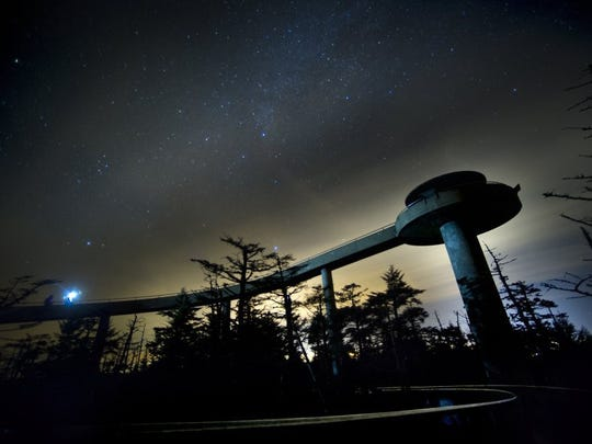Visitors Mike Henry of Ann Arbor, Mich., and Matt Hutton of San Luis Obispo, Calif., round the walkway to the Clingmans Dome observation tower beneath starry autumn skies on Nov. 30, 2013, in the Great Smoky Mountains National Park.