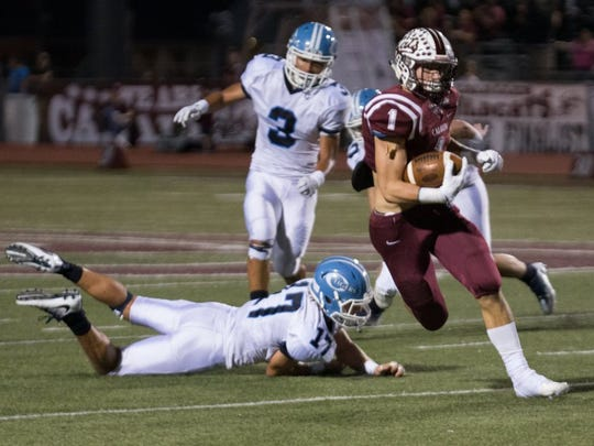 TRACY WEDDLE/SPECIAL TO THE CALLER TIMES Calallen's John Gaddis (1) manages to evade the Tiger defense for a first down.