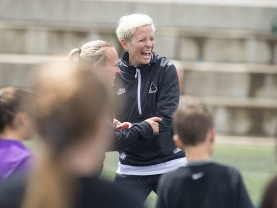 photos by Michael Burke/Record searchlight Megan Rapinoe enjoys a laugh with a fellow coach during her performance training clinic at the Redding Soccer Park on Sunday. Participants were eager to learn from the USA Gold Medalist, who is recovering from ACL surgery in December.