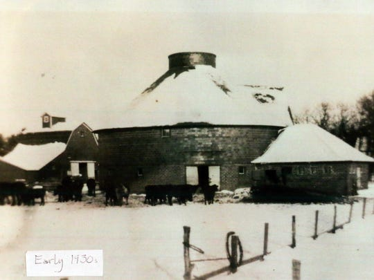 Loie Hayward's brick barn is shown in a photo from the early 1930s. The barn was built in 1917 on her family's farm just north of Dysart. The barn is one of at least 89 on display Sept. 26 and 27 as part of the Iowa Barn Foundation's statewide tour. Note the roof -- higher here than the replacement roof installed after a 1960 tornado.