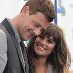 This Aug. 19, 2012 file photo shows Cory Monteith, left, and Lea Michele at the 2012 Do Something awards in Santa Monica, Calif.  Monteith, who shot to fame in the hit TV series 'Glee' but was beset by addiction struggles so fierce that he once said he was lucky to be alive, was found dead in a Vancouver hotel room, police said. He was 31.
