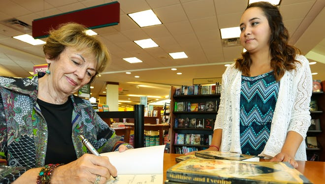 "Las Cruces author Paula Moore signs her book ""Matinee and Evening: The Story of Actors Abby Lewis and John Seymour""  for New Mexico State University journalism student Alexis Rico at the NMSU Barnes & Noble during a recent presentation."