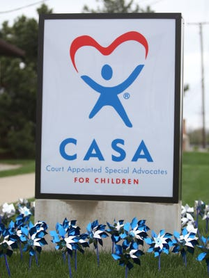 "Pinwheels spin in a ""Prevent Child Abuse Pinwheel Garden"" outside of the Court Appointed Special Advocates (CASA) offices on West Kilgore Avenue in this file photo from 2011."