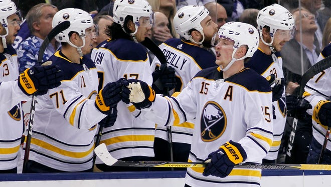 Jack Eichel celebrates his game-winning goal against the Maple Leafs.