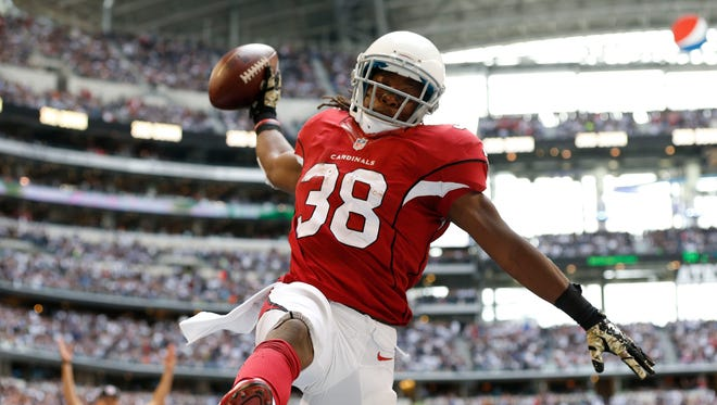 Nov 2, 2014: Cardinals running back Andre Ellington (38) spikes the ball after scoring a touchdown in the fourth quarter against the Dallas Cowboys at AT&T Stadium.