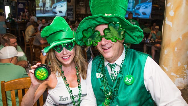 Lori Zencka and Robert Keegan celebrate St. Patrick's Day at the Skeptical Chymist in Scottsdale, Friday, March 17, 2017.