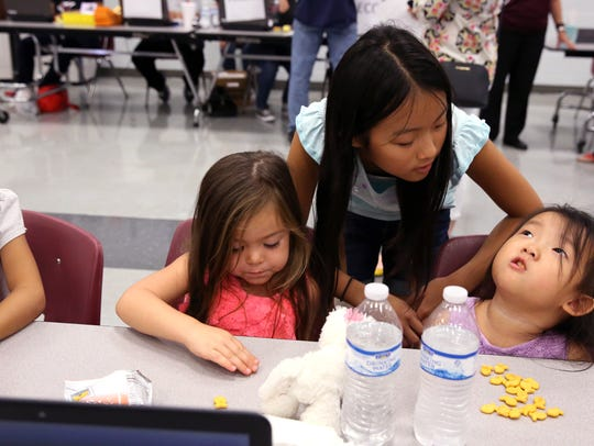 Alice Liu (from left), 6, Harper Norton, 3, Linda Liu,