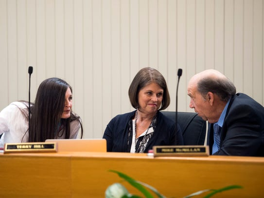 From left, Knox County school board members chat before