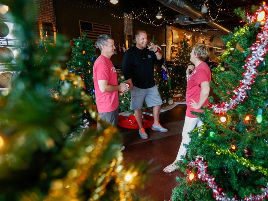 The holiday Miracle pop-up bar craze will return to Springfield in 2018 with two venues on Park Central Square, participating in partnership with Child Advocacy Center. In this July 25, 2017 photo, guests talk among Christmas trees during a sneak peak of the Miracle on Walnut event.
