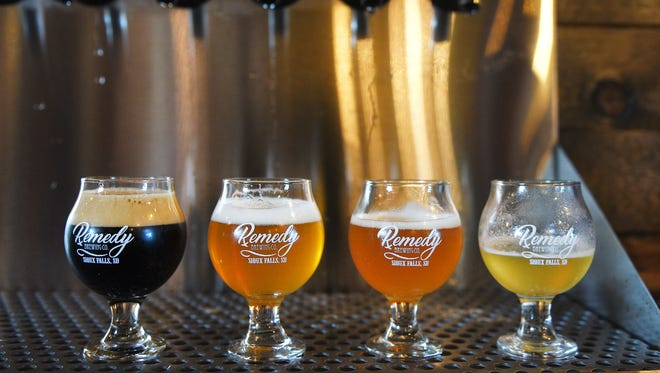 Remedy Brewing prepares for the Friday night crowd Friday, July 21, at the brewery.