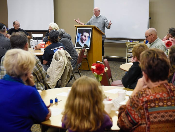 Gene Short leads a prayer service for missing college
