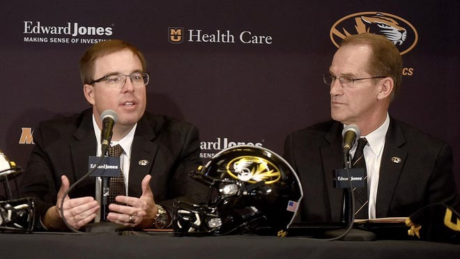 Missouri head football coach Eliah Drinkwitz, left, answers question from the media alongside athletic director Jim Sterk on Dec. 10 at the Show-Me Club in the South End Zone complex at Memorial Stadium.