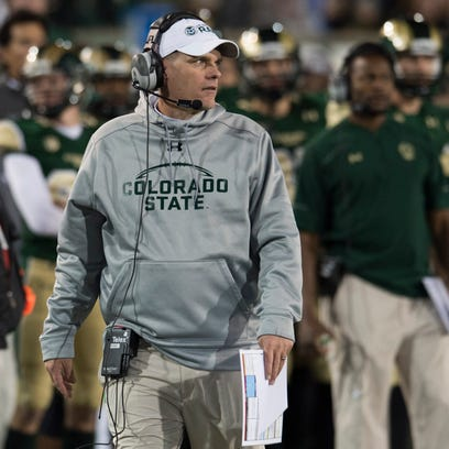 CSU coach Mike Bobo walks the sidelines during the