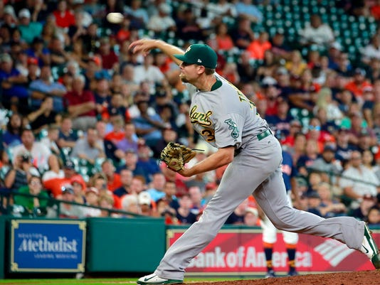 Oakland Athletics' Blake Treinen pitches in relief against the Houston Astros in the eighth inning of a baseball game, Sunday, Aug. 20, 2017, in Houston. (AP Photo/Richard Carson)