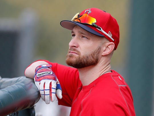 Los Angeles Angels catcher Jonathan Lucroy (20) gets ready for batting practice during spring training at Tempe Diablo Stadium.