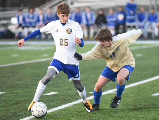 Mountain Home's Koby Weber controls the ball against
