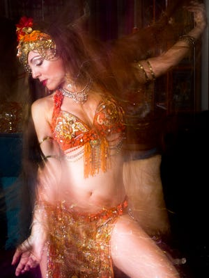 Ansuya Rathor belly dances for a portrait in her home in North Naples on Friday, February 24, 2017. Rathor had her first belly dancing performance at the age of four. She teaches belly dancing classes online and in person in Naples.