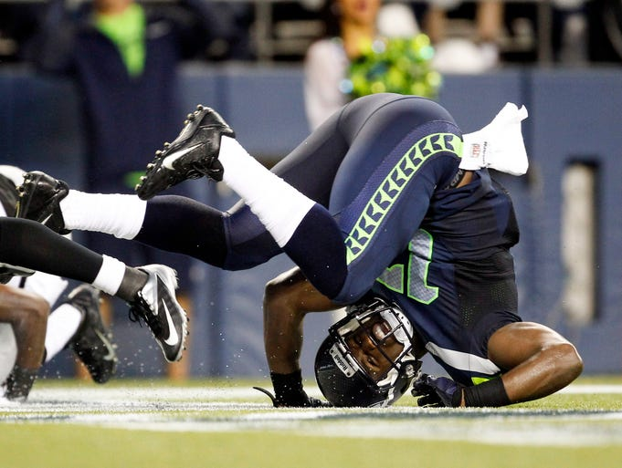 Seattle Seahawks wide receiver Chris Harper (17) tumbles through the end zone after dropping a potential touchdown pass during the second quarter at CenturyLink Field.