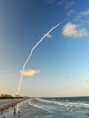 Crowds watch the launch from Cocoa Beach.