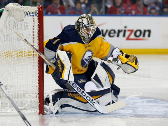 Sabres goalie Jhonas Enroth (1) looks for the puck during the first period against the Montreal Canadiens at First Niagara Center last March.
