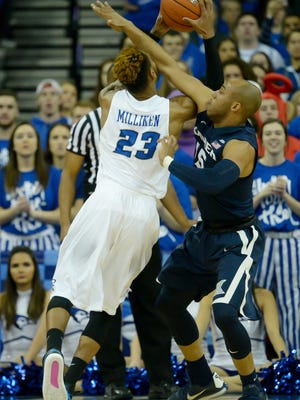 Xavier Musketeers guard Myles Davis (15) fouls Creighton Bluejays guard James Milliken (23) during the first half at CenturyLink Center Omaha.