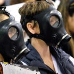 Protesters wearing gas masks attend a hearing Jan. 16 over a gas leak at the southern California Gas Co.'s Aliso Canyon Storage Facility near the Porter Ranch section of Los Angeles.