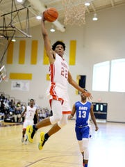 Roydell Brown makes a basket during the LHSBCA Boys