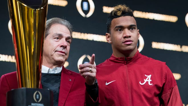 Alabama head coach Nick Saban and quarterback Tua Tagovailoa stand beside the National Championship Trophy  in Atlanta, Ga., on Tuesday January 9, 2018, during a press conference the day after winning the College Football Playoff National Championship.