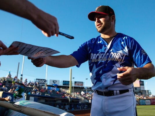 El Paso's Cody Decker signs autographs for fans prior to the Triple-A Home Run Derby on Monday at Werner Park in Papillion, Neb.
