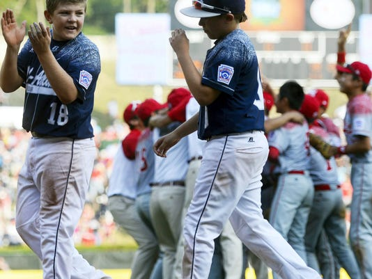 Red Land's Dylan Rodenhaber claps as he takes the field with his team after losing to Japan in the Little League World Series Championship. Japan beat Red Land, 18-11.