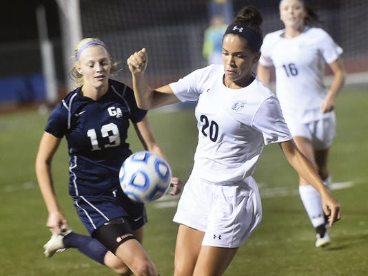 Greencastle-Antrim's Hannah Crist (13) closes in on Cirsten Kelly of Chambersburg during the teams' 2-2 draw on Saturday night.