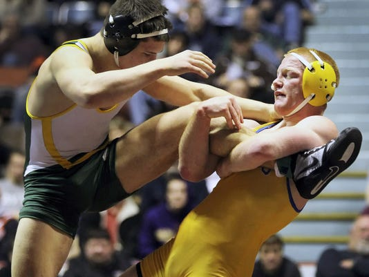 Kennard-Dale's Chance Marsteller works to take down Central Dauphin's Garrett Peppelman during their District 3 Class AAA finals bout at 160 pounds last year at Hersheypark Arena. Peppelman said Marsteller is humble but puts off an aura that he will dominate his opponents on the mat.