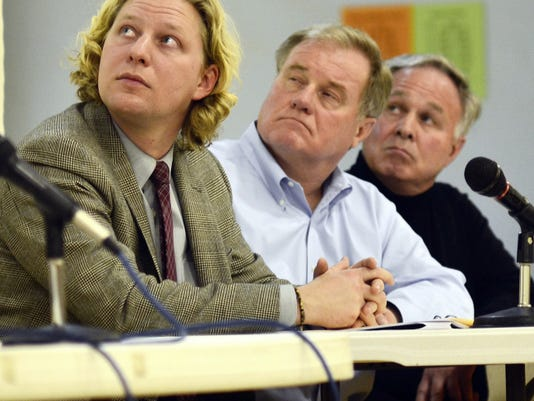 From left, state Rep. Kevin Schreiber, D-York City, state Sen. Scott Wagner, R-Spring Garden Township, and York County Commissioner Doug Hoke watch a presentation about the effects of heroin use in York County during a heroin task force meeting at Crispus Attucks.