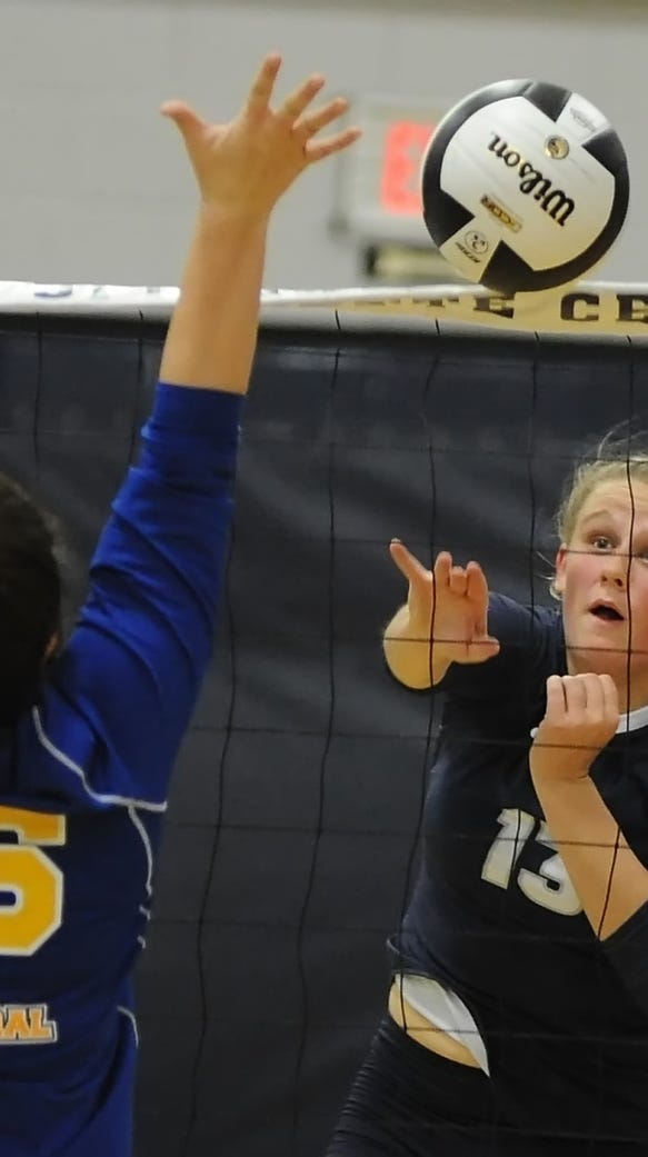 Jozee Evans lays the ball over the net for Central