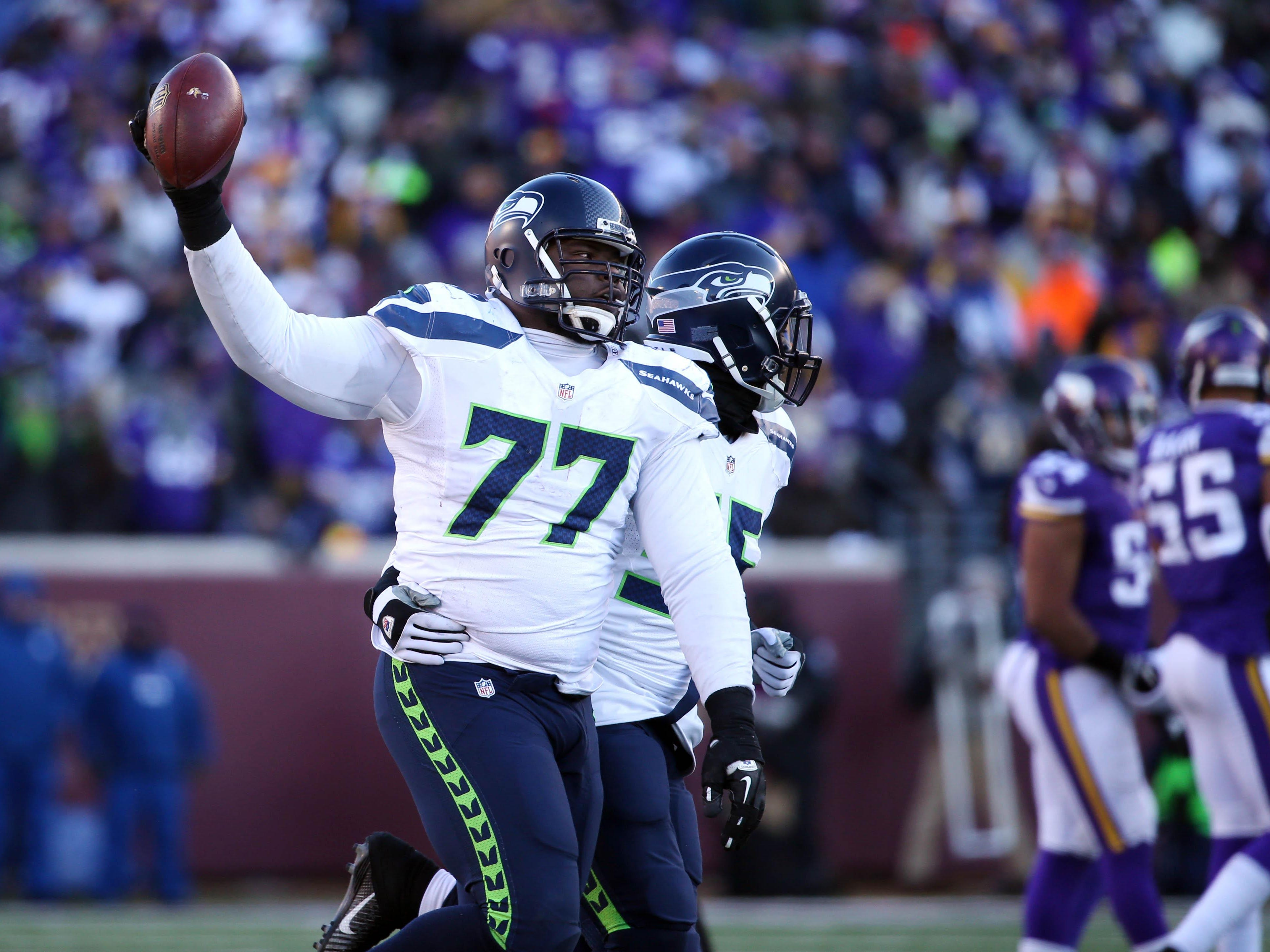Brace Hemmelgarn/USA TODAY Sports Seahawks defensive tackle Ahtyba Rubin (77) celebrates after recovering a fumble against the Minnesota Vikings. Jan 10, 2016; Minneapolis, MN, USA; Seattle Seahawks defensive tackle Ahtyba Rubin (77) celebrates after a recovered fumble against the Minnesota Vikings in the fourth quarter of a NFC Wild Card playoff football game at TCF Bank Stadium. Mandatory Credit: Brace Hemmelgarn-USA TODAY Sports