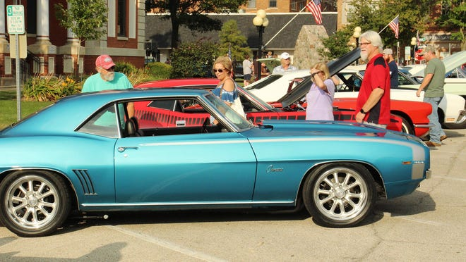 Car enthusiasts paraded in downtown Pontiac Saturday to look over well-conditioned automobiles of yesteryear.