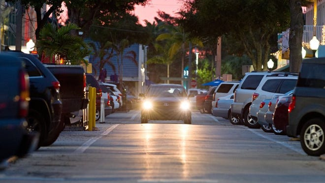 A driver heads south through downtown Stuart, past filled parking spaces on Southwest Osceola Street. Parking in downtown Stuart is often crowded during the November-to-April tourist season. City officials are hoping valet parking will ease the problem.